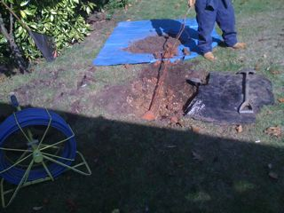 Using CCTV and tracers engineers was able to excavate the grass down onto the drain and pull out the massive roots that were causing the drain to back up and flood the man hole