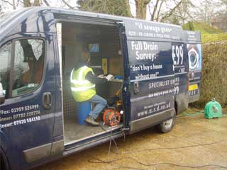 Engineer is carrying out CCTV survey of the before and after drain system from the survey room inside the vehicle