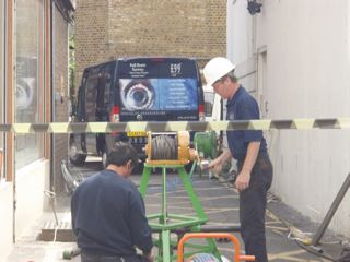 Engineers using remote on the floor and also hand winching through the re-rounding tool (what we like to call in the trade, a metal bomb) which is pointed at both ends to allow to move slowly along through the crushed and deformed areas of the pitch fibre thus allowing it to pull back into shape